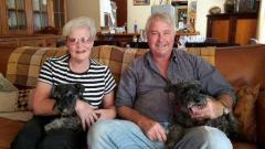 Len and Lyn Nel with the schnauzer family
